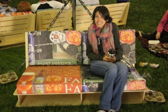 on a bench at New Belgium event